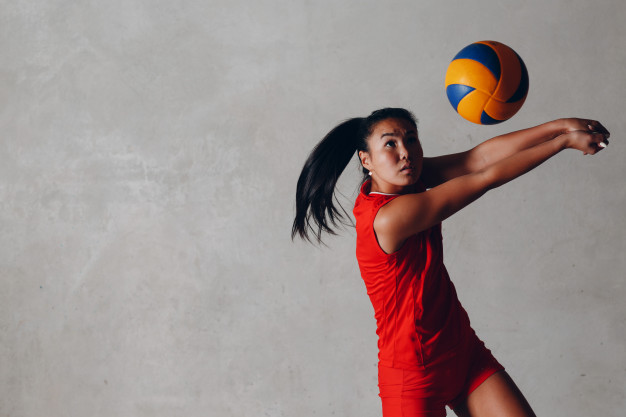 young asian woman volleyball player red uniform takes ball 183314 1068