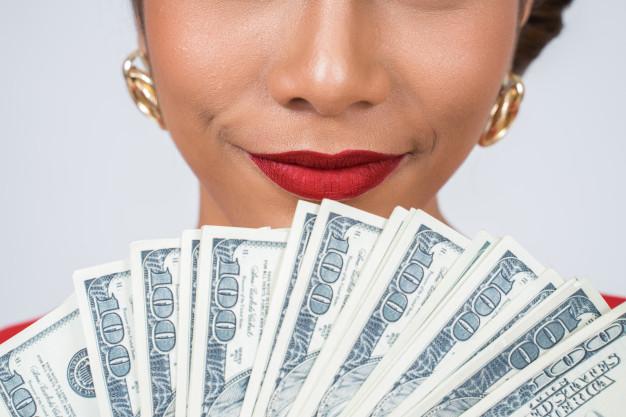 happy fashion beautiful woman hand holding dollar money 1150 14170