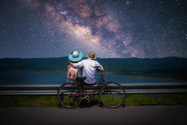 couple traveler sitting near bicycle looking milky way stars sky 45381 287