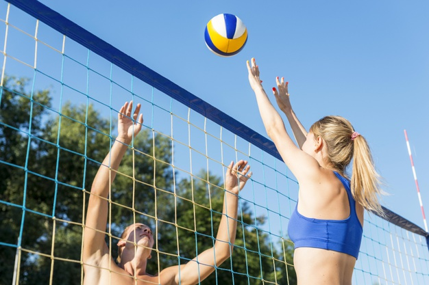 side view woman man playing beach volleyball 23 2148662639
